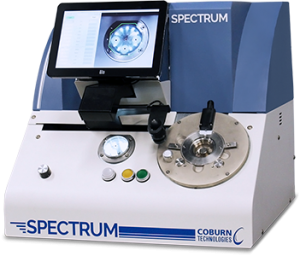 Spectrum Prismatic Lens Blocker by Coburn Technologies, machine facing front with screen turned on.
