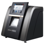 EXXPERT Express HPE-910 Lens Edger by Coburn Technologies, facing the right side with screen turned on.