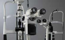 Two Huvitz slit lamps facing opposite directions. Left side slit lamp is the HS-7000 with tower illumination. Right slit lamp is the HS-7500 with integrated illumination.